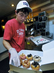 Brandon Bless makes doughnuts. The Doh-Nuh T Company is the latest place for made-to-order doughnuts in Chambersburg.