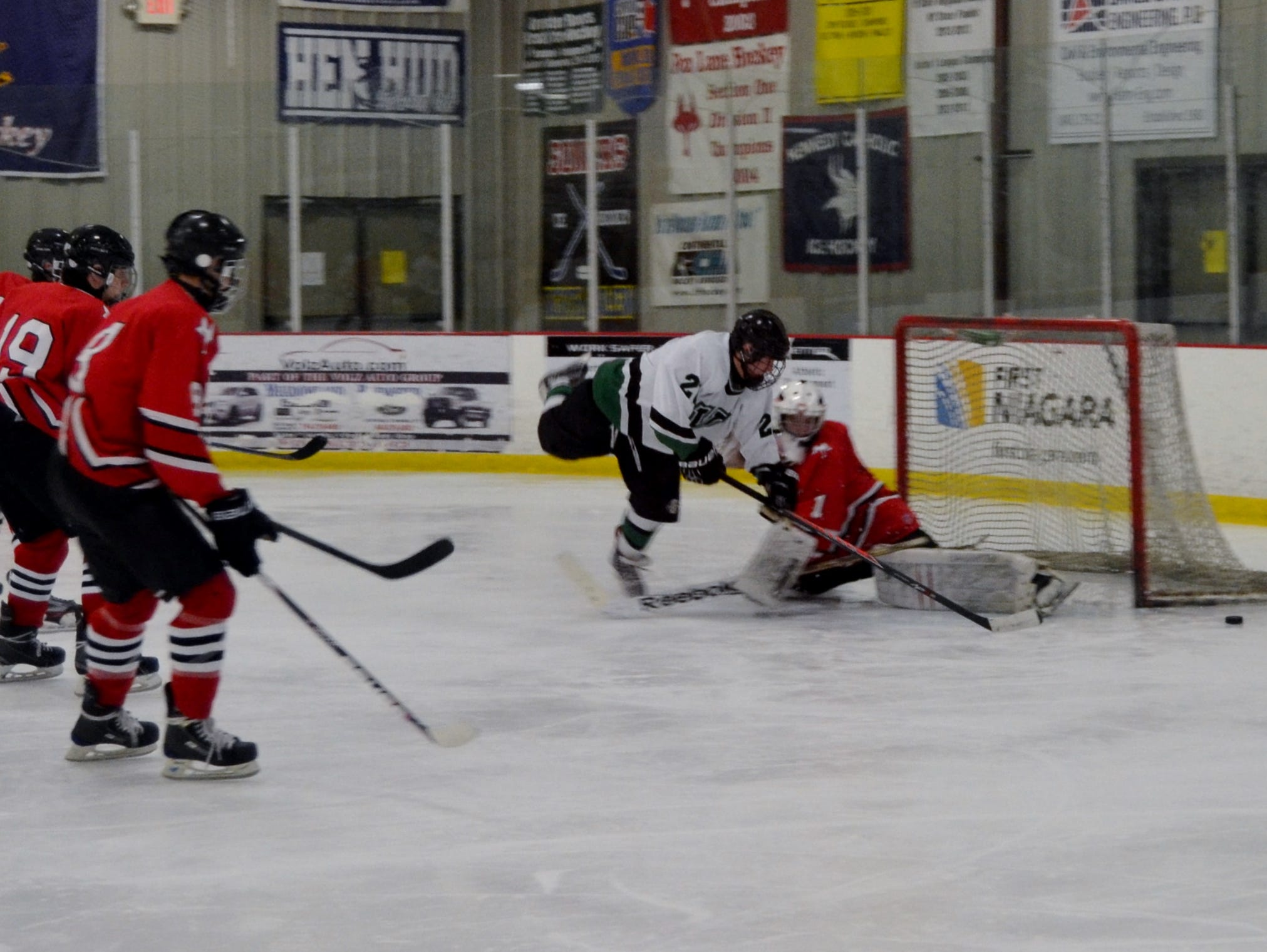 Fox Lane goalie Abbie Ives stops Yorktown's Liam Donnelly on a rush during a 4-2 win Sunday in the opening round of the Section 1 Divison 2 tournament at BIA.