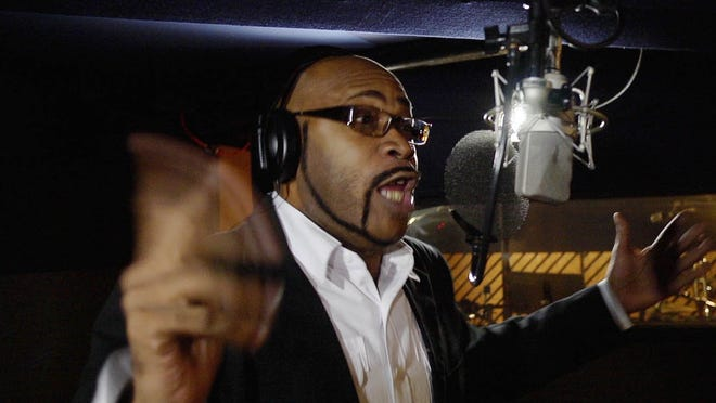 """Frame grab from a scene in """"Let's Have Some Church Detroit Style"""" featuring director E. LaQuint Weaver in a recording session."""