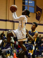 Crisfield's Ryan Waters takes the ball to the basket