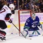 Arizona Coyotes host Vancouver Canucks as play against Pacific Division continues