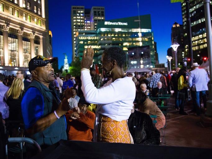 Michael Elliott, left, of Detroit, dances with Ms.