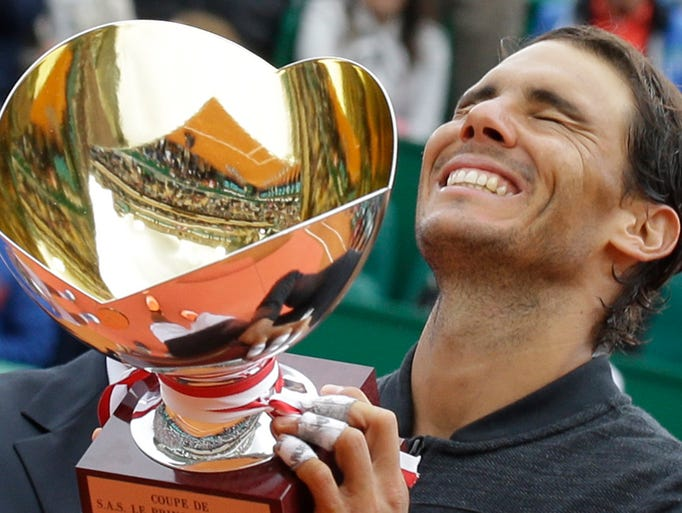 Spain's Rafael Nadal holds up his trophy after winning