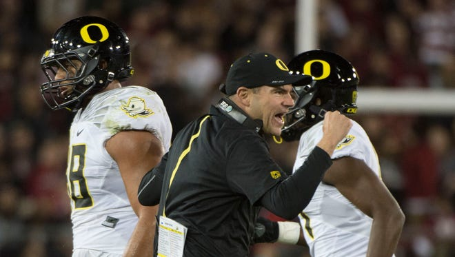 November 14, 2015; Stanford, CA, USA; Oregon Ducks head coach Mark Helfrich celebrates after a play during the third quarter against the Stanford Cardinal at Stanford Stadium. The Ducks defeated the Cardinal 38-36. Mandatory Credit: Kyle Terada-USA TODAY Sports