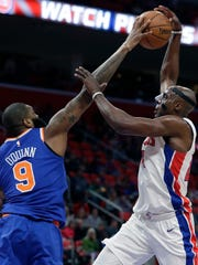 Knicks center Kyle O'Quinn (9) blocks a shot by Detroit Pistons forward Anthony Tolliver during the first half Friday night in Detroit.