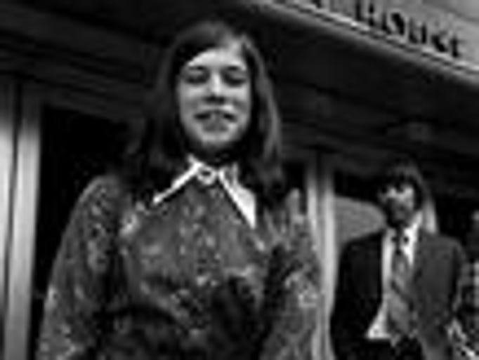 Ambra Offutt, left, 12, arrives at federal district court in Nashville for a hearing on her lawsuit against the Little League May 9, 1974. Her father, John, a high school English teacher, is waiting on her in the background. U.S. District Court Judge L. Clure Morton took under advisement on her plea to be allowed to play baseball in the all-boys Little League of Nashville.