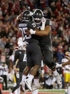 Washington State running back Jamal Morrow (25) celebrates his touchdown with offensive lineman Frederick Mauigoa (69) during the first half of an NCAA college football game against Southern California in Pullman, Wash., Friday, Sept. 29, 2017. (AP Photo/Young Kwak)