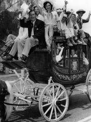 Desert Circus Parade, Walt Disney with local kids in Disneyland Stagecoach c. 1955