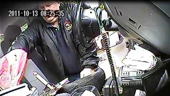This Oct. 13, 2011 image taken from surveillance video and released by the U.S. Attorney?s Office for the Northern District of New York,  former parking meter mechanic James Bagarozzo throws a handful or quarters into a red bag on the seat of a truck while working his job in Buffalo, N.Y. Bagarozzo is one of two former parking meter mechanics who face sentencing for stealing thousands of dollars in quarters from Buffalo parking meters while on the job, Thursday, Aug. 15, 2013.