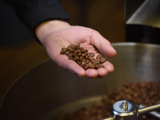 Corey Gerlach binds roasted coffee beans during a Breaks