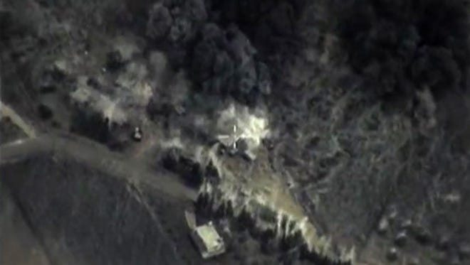 An image on the Russian Defense Ministry's website purports to show an airstrike Sept. 30, 2015, in Syria.