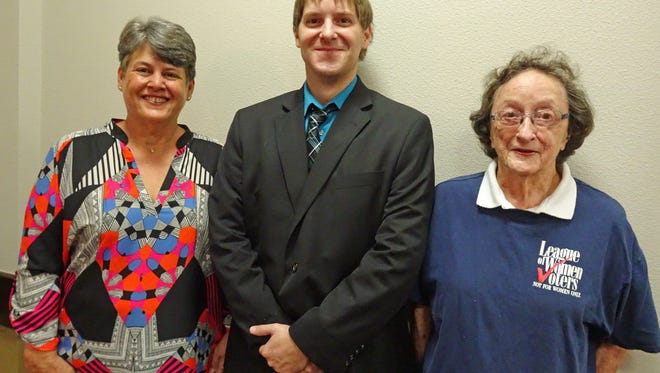 """Program co-chairs Nita Tillery, left, and Roberta Sund, right, are pictured with Kyle Keep, Midwestern State University political science lecturer who spoke to the League of Women Voters about the proposed amendments to the Texas Constitution. The title of his talk was """"Constitutional Amendments: Preparing To Vote."""" For information about voting, contact the County Clerk's office or the League of Women Voters, www.lwvwichitafalls.org."""