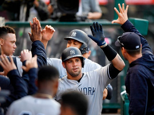 New York Yankees' Gary Sanchez is congratulated by teammates after hitting a two-run home run during the fourth inning.