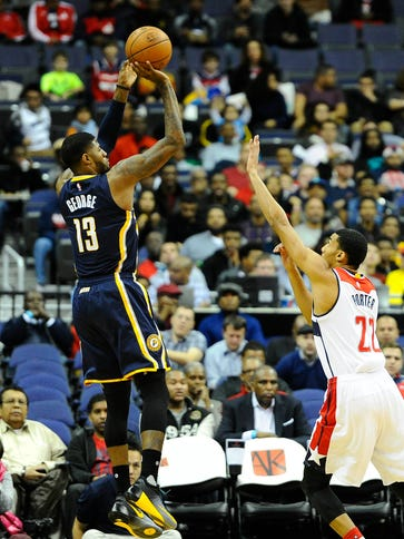 Pacers forward Paul George shoots over Wizards forward