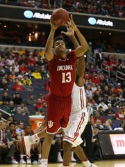 Mar 10, 2017; Washington, DC, USA; Indiana Hoosiers forward Juwan Morgan (13) shoots the ball as Wisconsin Badgers forward Vitto Brown (30) defends in the second half during the Big Ten Conference Tournament at Verizon Center. Mandatory Credit: Amber Searls-USA TODAY Sports
