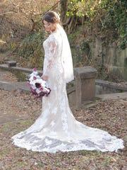 Tori Bates showcases her wedding dress at her wedding