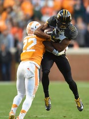 Tennessee defensive back Micah Abernathy takes down Missouri wide receiver Emanuel Hall during the first half Saturday at Neyland Stadium.