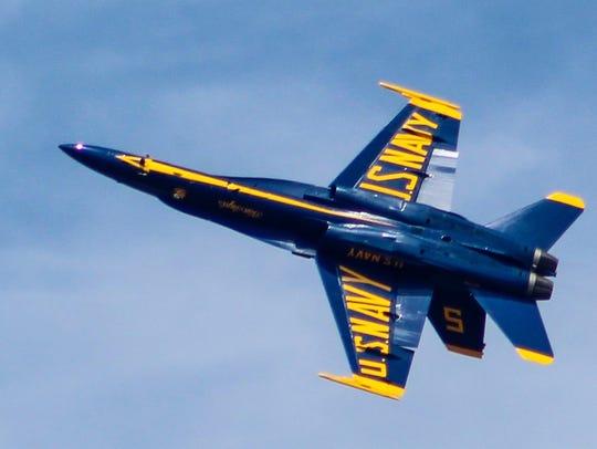 A Blue Angel Navy fighter plane flies over Biloxi recently