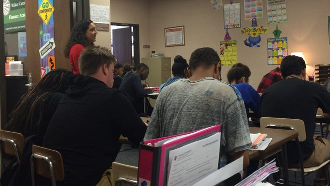 Jenna Burns, a finance teacher at Warren Central High School, teaches students investing terms. The course features materials from financial expert Dave Ramsey.