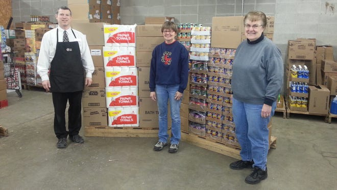 Fox's Piggly Wiggly of Two Rivers has made a donation to Two Rivers Ecumenical Pantry. Nearly $1,000 of groceries were recently given to the organization, which helps local families in need. Funds were raised during Piggly Wiggly's annual Christmas Ball Bonanza. Pictured from left are Rob Ullman, manager of Fox's Two Rivers location; Lynn Skarvan, TREP coordinator; and Sonja DeVore, TREP assistant coordinator.