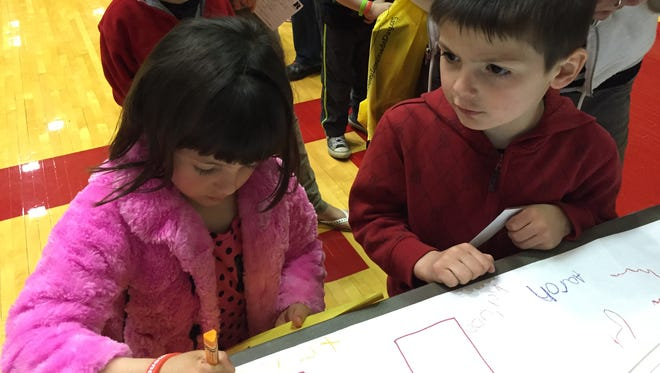 At the 2015 Kindergarten Rocks and Preschool Rules registration event for Richmond Community Schools, Trinity Close and Aaron Close signed a banner at the Morrisson-Reeves Library table. This year's event is 5-7 p.m. April 14.