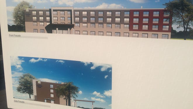 Brighton City Council members on Thursday viewed this artist's rendering of the front and side of the planned Holiday Inn Express.