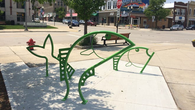 Fish-themed bike racks sit on the corner of 8th and Quay Streets in downtown Manitowoc.