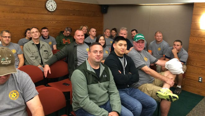 Livingston County Sheriff's Department officers and supporters packed the boardroom at a meeting of the Board of Commissioners. Many spoke out to ask county officials to give correction officers a 2.5 percent raise.