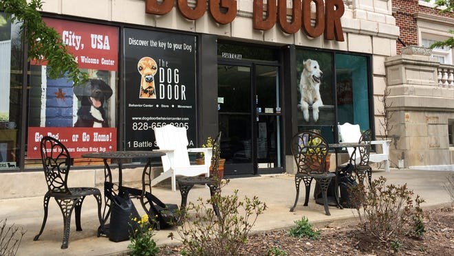 Dog clients of the Dog Door business in the Battery Park Apartments building, as well as dogs owned by apartment residents, have been urinating on shrubbery out front, killing some of it.