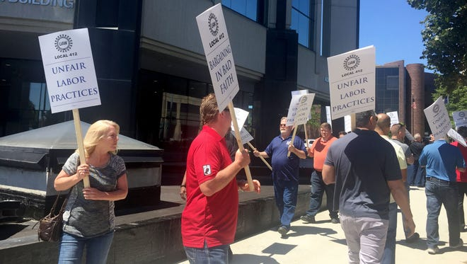 Group of about 20 union picketers participate in a informational picket outside the Macomb County administration building in downtown Mt. Clemens on June 7, 2017. The picket was to demonstrate unfair labor practices, such as harassment and intimidation, by the new county Clerk/Register of Deeds Karen Spranger.
