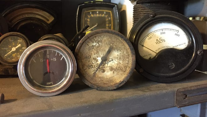 Three gauges wait to be re-purposed at Imperial Auto and Collectibles in China Township.