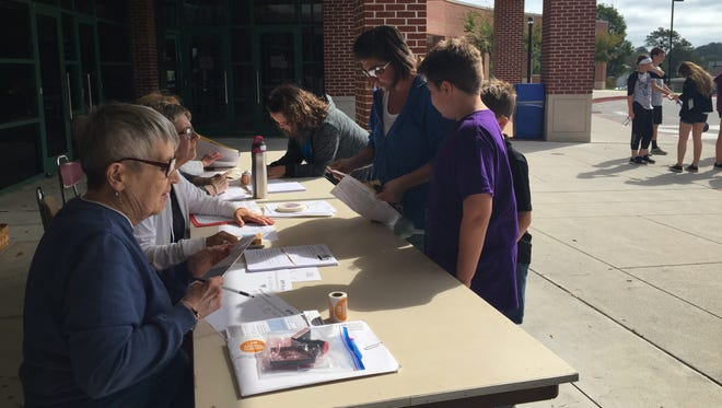 Walkers registering to walk in the 41st Hanover CROP walk on Oct. 15, 2017.