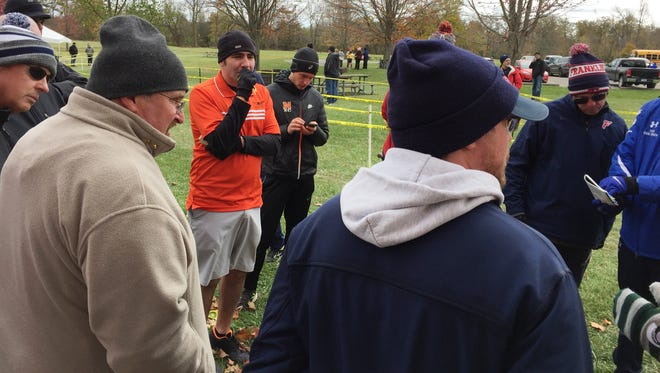 Northville coach Tim Dalton (orange shirt) pleads his case after his team was disqualified from the regional.