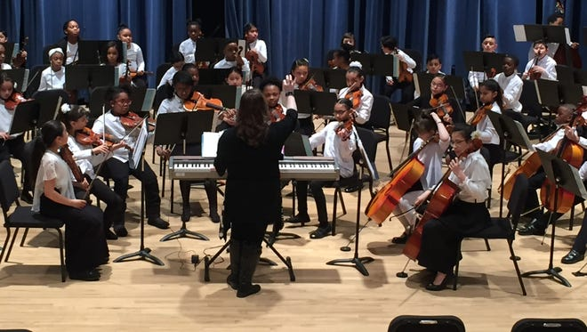 Mary Pat Michaels leads the Milwaukee Youth Symphony Orchestra's Progressions string orchestra in concert at the Milwaukee Youth Arts Center. Patrick Rath, a former chair of MYSO's board of directors, is the United Performing Arts Fund's new president and CEO.