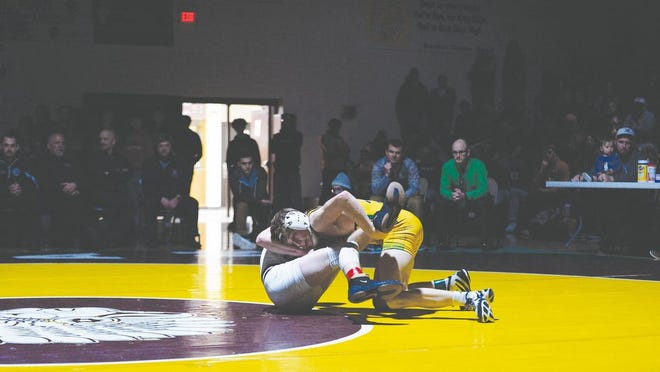 Devon Weber gets a take down against Dylan Sheler from Campus during the finals at the  Bob Kuhn Prairie Classic on Saturday in Hays. Weber won the match 5-3 for the championship.
