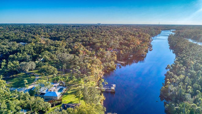 Sitting in the heart of The Trails community of Ormond Beach, this gated riverfront estate is nestled on 5.25 acres that could possibly be subdivided up into five lots. {Realty Pros Assured]