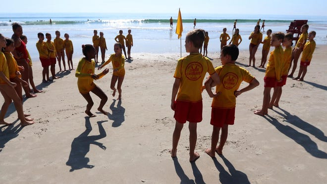Junior Lifeguards workout on the beach at Andy Romano Beachfront Park in Ormond Beach last week. Summer training for the group goes through July 31.