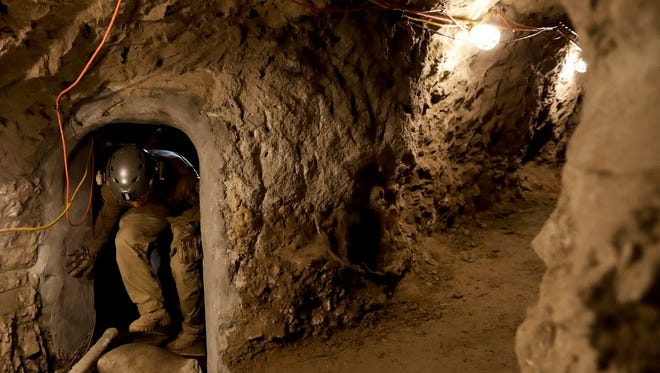"""In this March 6, 2017 photo, a member of the Border Patrol's Border Tunnel Entry Team enters a tunnel spanning the border between San Diego and Tijuana, Mexico, in San Diego. They are known in the Border Patrol as """"tunnel rats"""" - agents who go in clandestine passages that have proliferated on the U.S.-Mexico border over the last 20 years to smuggle drugs. (AP Photo/Gregory Bull)"""