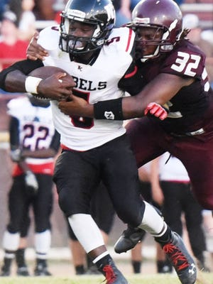 North Caddo's Tymon Sanders tries to get past Booker T Washington's Sha'Micheal O'neal during Friday's game at Booker T Washington.
