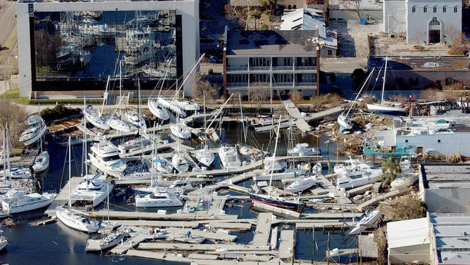 Boats docked at the pier on the end of South Palafox Street were shoved to the sea wall and left resting on top of each other after Hurricane Ivan in 2004.