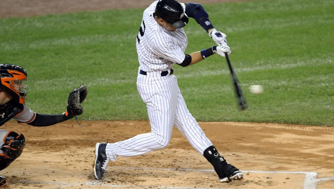 Yankees shortstop Derek Jeter hits an RBI double in the first inning against the Orioles during his last game at Yankee Stadium on Thursday night.