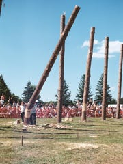 "One of the ""trees"" is felled during a competition at a previous Woodsmen Show."