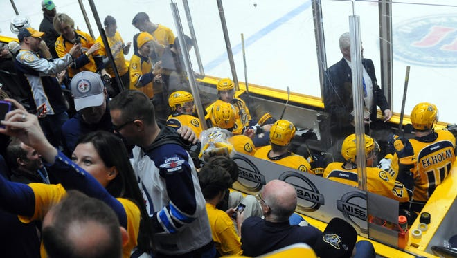 Predators players sit in the penalty box after five minor misconduct penalties were called in the third period Saturday.