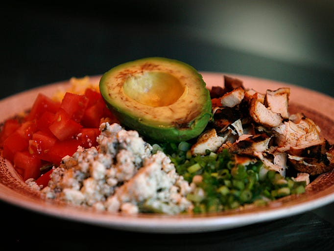 Chef Jay Gundy's Cobb salad features diced tomatoes, blue cheese, scallions, grilled chicken and topped with avocado.