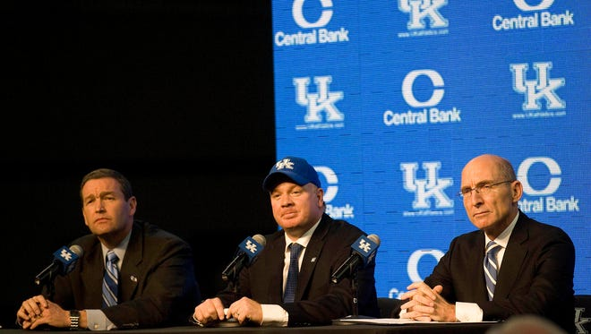 Dec 2, 2012; Lexington , KY, USA; Kentucky Wildcats head coach Mark Stoops spoke with reporters with Athletic director Mitch Barnhart (left) and University of Kentucky President Eli Capilouto (right) at the Nutter Field House.
