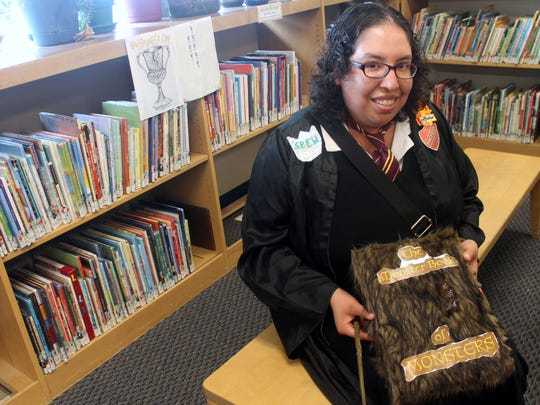 Ronda Sepulveda shows off her Book of Monsters at the Alamogordo Public Library. Sepulveda ultimately took first place in the adult costume contest.