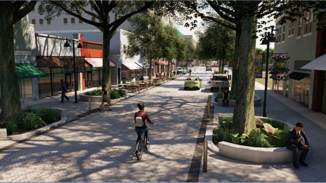 New look coming for Clematis Street's 400 and 500 blocks. This rendering shows fewer on-street parking spots, wider sidewalks for outdoor dining, and more shade trees, with palms for corner accents.