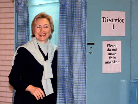 Hillary Clinton exits a voting booth after casting