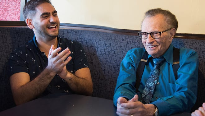 """Alex Banayan, a young author of the book """"The Third Door"""" speaks with famed television host Larry King."""