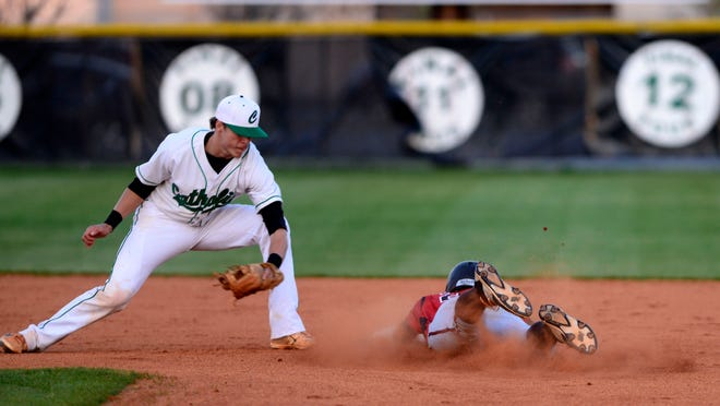 West Florida High School's Kristofer Reber steals second base Friday before Catholic's Brandon Lockridge can tag him out.